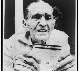 Centenarian Frances Perry holds Medicare card on the first day of the program's operation, Dallas, Texas, 1966