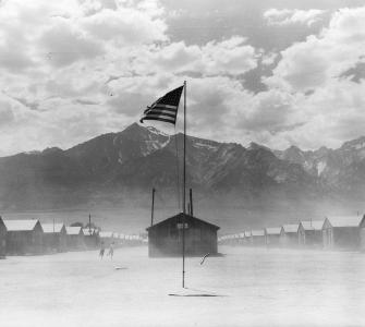 Dust storm at Manzanar War Relocation Authority Center, photograph by Dorothea Lange, July 3, 1942