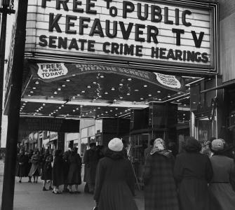 Women and Young Girls Entering Movie Theater to See Free TV of Kefauver Senate Crime Hearings, photograph by Michael Rougier, 1951