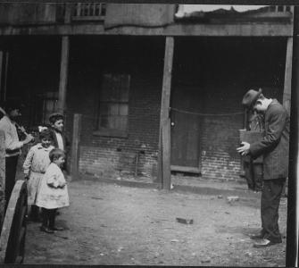 Lewis Hine photographing children, photograph, ca. 1910