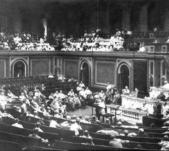 Here, in a rare photograph of the House in session, Jeannette Rankin addresses her colleagues during her first term in Congress, 1917–1919.