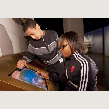 Students at one of 24 interactive computer stations inside the Capitol Visitor Center's Exhibition Hall