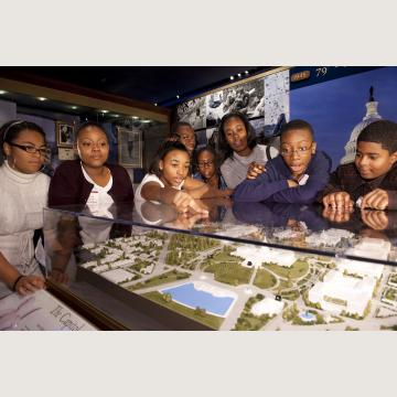 Students explore a scale model of the Capitol campus in the Capitol Visitor Center's Exhibition Hall