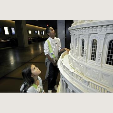 Children exploring the touchable scale model of the Capitol dome in the Capitol Visitor Center's Exhibition Hall
