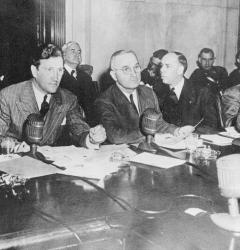 The Truman Committee is shown meeting in the Senate Caucus Room, 1943.