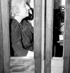 In a Capitol phone booth, Jeannette Rankin calls for assistance following her vote against war on December 8, 1941.
