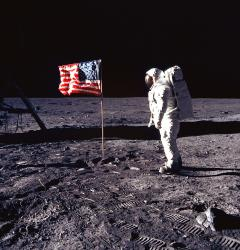 Astronaut Buzz Aldrin posed with the U.S. flag on the first lunar landing, July 20, 1969.