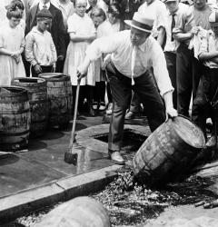 Police destroyed beer kegs when the Eighteenth Amendment took effect in 1920, banning the sale of alcoholic beverages.