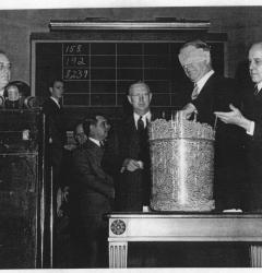 Selective service, or the draft, used a lottery to call up men for military duty. Here, President Franklin D. Roosevelt watches Navy Secretary Frank Knox draw a number.